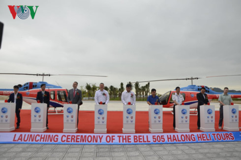 visitors savour spectacular views of ha long bay by bell 505 helicopter hinh 0
